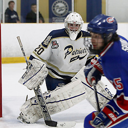 TORONTO, ON - Apr 1, 2015 : Ontario Junior Hockey League game action between the Toronto Jr. Canadiens and the Toronto Patriots.  Game four of the South West Championship Series. Mathew Robson #20 keeps an eye of the Toronto Jr Canadiens.<br /> (Photo by Brian Watts / OJHL Images)
