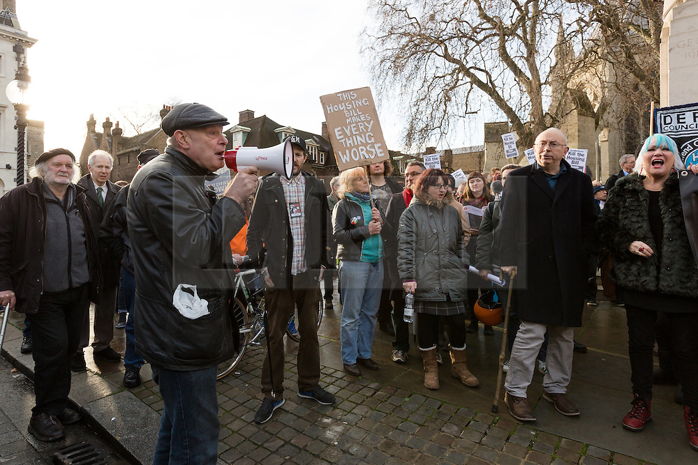 © Licensed to London News Pictures. 05/01/2016. London, UK. Protesters from Defend Council Housing (DCH) are joined by housing groups, trades unions and Class War to stage a protest against the Housing Bill outside the Houses of Parliament in Westminster. The protesters then marched to Downing Street before returning to parliament. MP's will debate the Housing and Planning Bill  in parliament today, which makes provisions about social housing, right to buy, estate agents, rent charges, planning and compulsory purchase. Photo credit : Vickie Flores/LNP