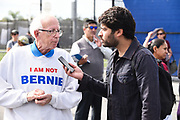 Bernie Sanders Rally Interviewer Speaking to a Sanders and Larry David look-alike at an Outdoor Rally