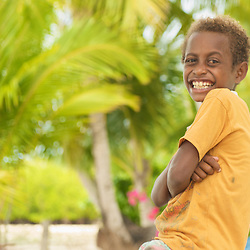 Portrait of a smiling papua boy.