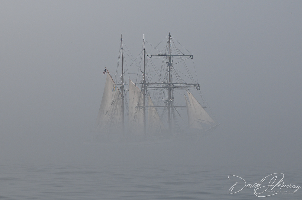Tall ship Gazela emerges from the fog as it approaches the entrance to the Piscataqua River entrance to Portsmouth Harbor