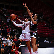 09 November 2018: San Diego State Aztecs guard Te'a Adams (5) lays the ball up while being closely guarded by Hawaii Warriors guard Courtney Middap (2) in the third quarter. The Aztecs opened up it's regular season schedule with a 58-57 win over Hawaii Friday at Viejas Arena.