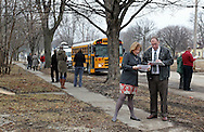 City Council member Monica Vernon (from left) and Joe O'Hern, City Flood Recovery and Reinvestment director, look over property maps at the J Ave NW and Ellis Blvd NW location as members of the Northwest Recreation Center Task Force take a bus tour of the five possible sites for a new recreation center in Cedar Rapids on Thursday morning, February 23, 2012. (Stephen Mally/Freelance)