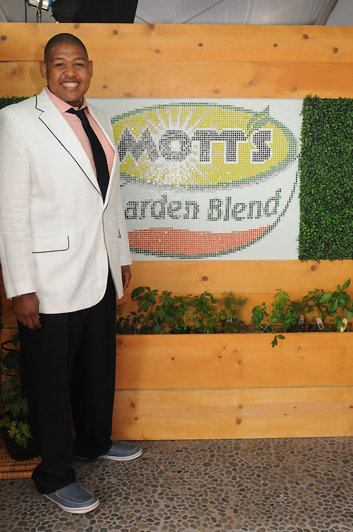 """Celebrating the launch of the new Mott's vegetable juice, Kate Walsh hosts the Mott's Garden Blend VIP Suite and helps Derby-goers get the day started """"on the right track,"""" Saturday, May 7, 2011 at the Kentucky Derby in Louisville, Ky. (Photo by Brian Bohannon)"""