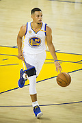 Golden State Warriors guard Stephen Curry (30) carries the ball down court against the San Antonio Spurs at Oracle Arena in Oakland, Calif., on October 25, 2016. (Stan Olszewski/Special to S.F. Examiner)