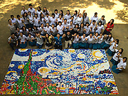TAICHUNG, CHINA - NOVEMBER 19: (CHINA OUT, TAIWAN OUT) <br /> <br /> Over Thirty Thousand Bottle Caps To Make Vincent Van Goghs The Starry Night<br /> <br /> Students and teachers pose with famous painter Vincent Van Goghs The Starry Night formed by more than thirty thousand bottle caps on November 19, 2015 in Taichung, Taiwan of China. The The Starry Night is in 5.4 meters long and 3.6 meters wide. <br /> ©Exclusivepix Media