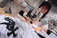 4/3/09 10:49:17 AM -- Easton, PA, U.S.A. -- Barbara Graver, a seamstress at Majestic Athletic sews lettering on the back of a Chicago White Sox jersey April 3, 2009 in Easton, Pennsylvania. White Sox jerseys and gear have experienced a boost in sales with Obama, a White Sox fan, in the White House. -- .Photo by William Thomas Cain,  cainimages.com.