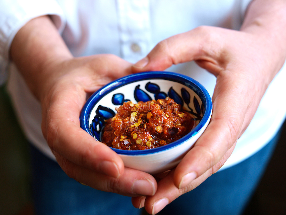 Chef Anissa Helou holds Harissa at the home of her friend, Palestinian singer Reem Kelani in London.