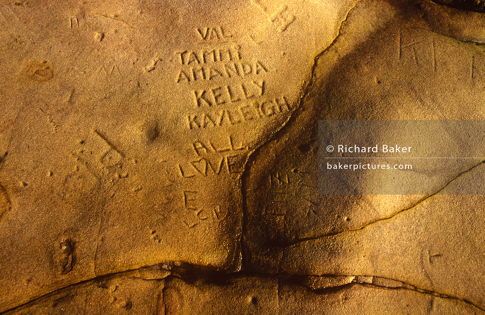 Visiting and local peoples' names carved into soft rock in the north-east coastal town of Cullcoates, Tyneside, England.