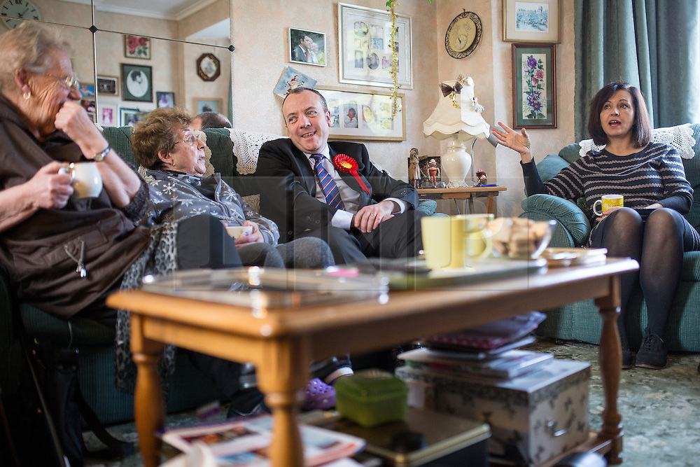 © Licensed to London News Pictures . 30/01/2014. Manchester, UK. L-R June Birds (74 , local pensioner) , Dee Amesbury , Mike Kane and Caroline Flint . Shadow Secretary of State for Energy and Climate Change , Caroline Flint MP , with PPC Mike Kane in the home of pensioners Dee (82) and Ted (88) Amesbury ahead of the Wythenshawe and Sale East by-election . Photo credit : Joel Goodman/LNP