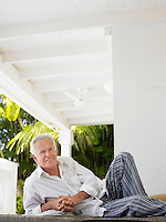 Man reclining on verandah portrait