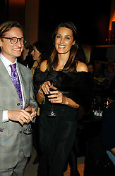 HAMISH BOWLES and YASMIN LE BON at a party to celebrate the first 20 years of fashion label Donna Karan held at her store at 19/20 New Bond Street, London W1 on 21st September 2004.<br /><br />NON EXCLUSIVE - WORLD RIGHTS