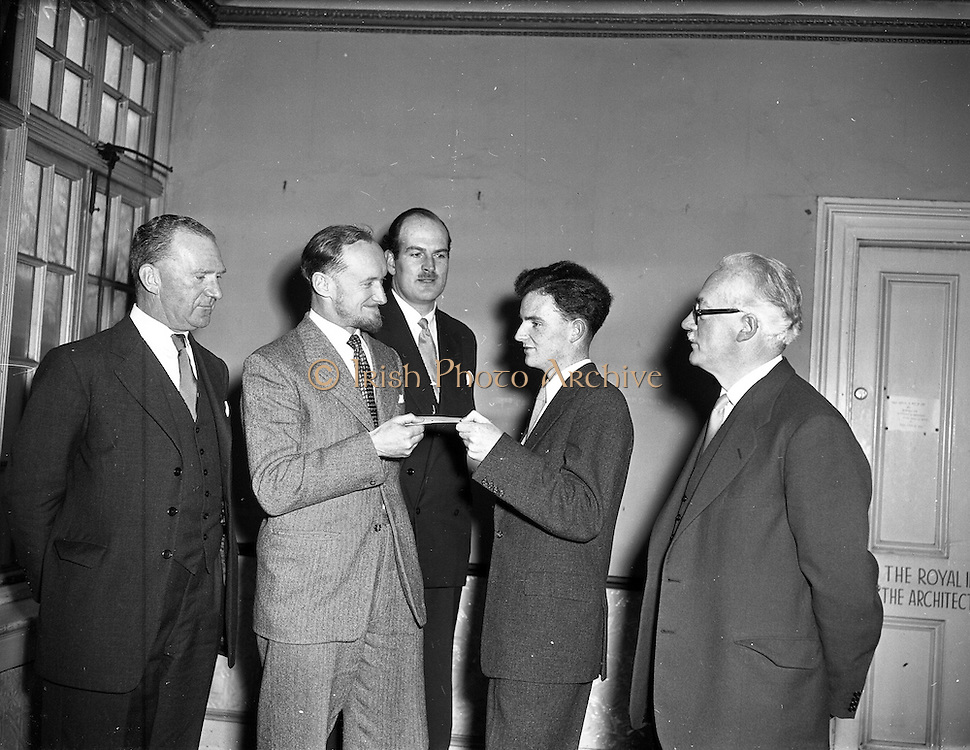 11/03/1957<br /> 03/11/1957<br /> 11 March 1957<br /> Hannington scholarship presentation by Hannington and Goodlass Wall at the Institute of Architecture, 8. Merrion Square, Dublin, to A. Gibney, Marino Park Avenue. Mr. Sydney Hannington Director, on left.