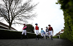 General view of jockey's walking into the parade ring before the Matchbook Betting Podcast Rosebery Handicap during the Easter Family Fun Day at Kempton Park Racecourse. PRESS ASSOCIATION Photo. Picture date: Saturday March 31, 2018. See PA story RACING Kempton. Photo credit should read: Steven Paston/PA Wire