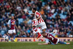 Stoke Midfielder Steven N'Zonzi (FRA) gets away from Aston Villa Defender Nathan Baker (ENG) - Photo mandatory by-line: Rogan Thomson/JMP - 07966 386802 - 23/03/2014 - SPORT - FOOTBALL - Villa Park, Birmingham - Aston Villa v Stoke City - Barclays Premier League.