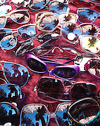 Sunglasses rest on red velveteen fabric from a street vendor in the Greenwich Village neighborhood of New York City.