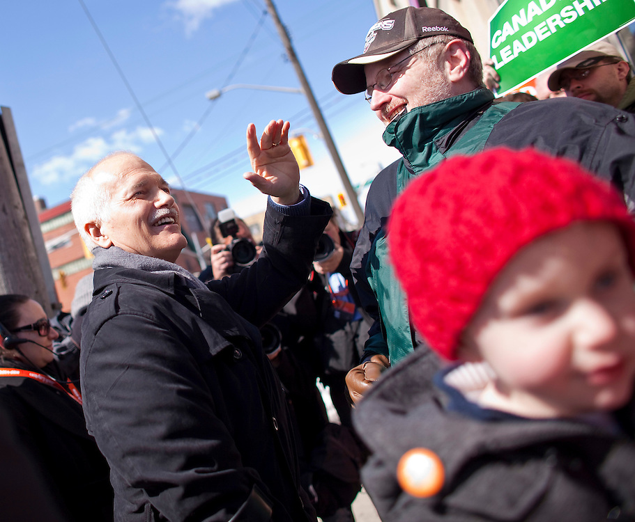 NDP leader Jack Layton waves to supporters during a campaign stop in Kitchener, Ontario, March 29, 2011. Canadians will be heading to the polls May 2.<br /> AFP/GEOFF ROBINS/STR