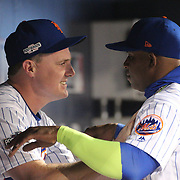 NEW YORK, NEW YORK - October 5: Yoenis Cespedes #52 with Jay Bruce #19 of the New York Mets of the New York Mets in the dugout during the San Francisco Giants Vs New York Mets National League Wild Card game at Citi Field on October 5, 2016 in New York City. (Photo by Tim Clayton/Corbis via Getty Images)