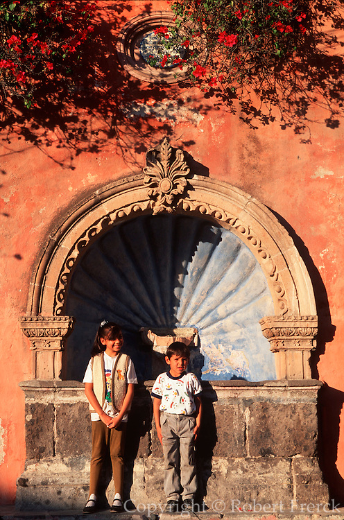 MEXICO, COLONIAL CITIES San Miguel de Allende; colonial city with many gringo residents; children in front  of a Spanish Colonial fountain