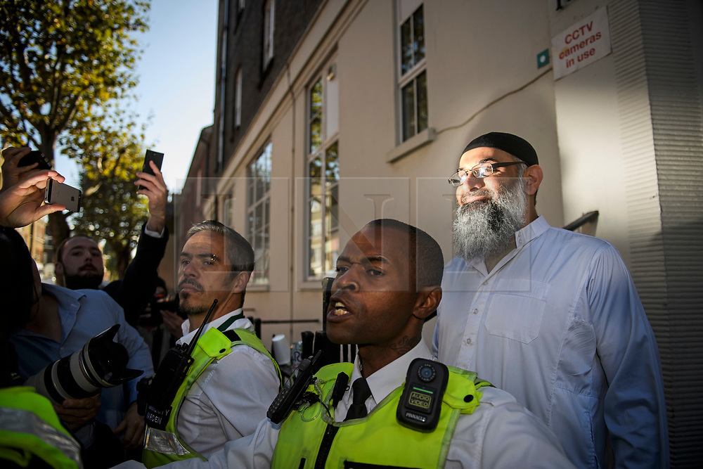 © Licensed to London News Pictures. 19/10/2018. London, UK. Radical preacher ANJEM CHOUDARY is seen surround by security at a bail hostel after being released form Belmarsh Prison in south-east London. Photo credit: Ben Cawthra/LNP