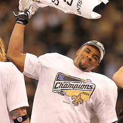 Jan 24, 2010; New Orleans, LA, USA; New Orleans Saints New Orleans Saints safety Darren Sharper waves a towel as he celebrates following an overtime victory over the Minnesota Vikings in the 2010 NFC Championship game at the Louisiana Superdome. Mandatory Credit: Derick E. Hingle-US PRESSWIRE