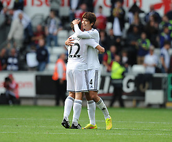 Swansea City's Angel Rangel celebrates there win with Swansea City's Ki Sung Tueng - Photo mandatory by-line: Alex James/JMP - Mobile: 07966 386802 30/08/2014 - SPORT - FOOTBALL - Swansea - Liberty Stadium - Swansea City v West Brom - Barclays Premier League