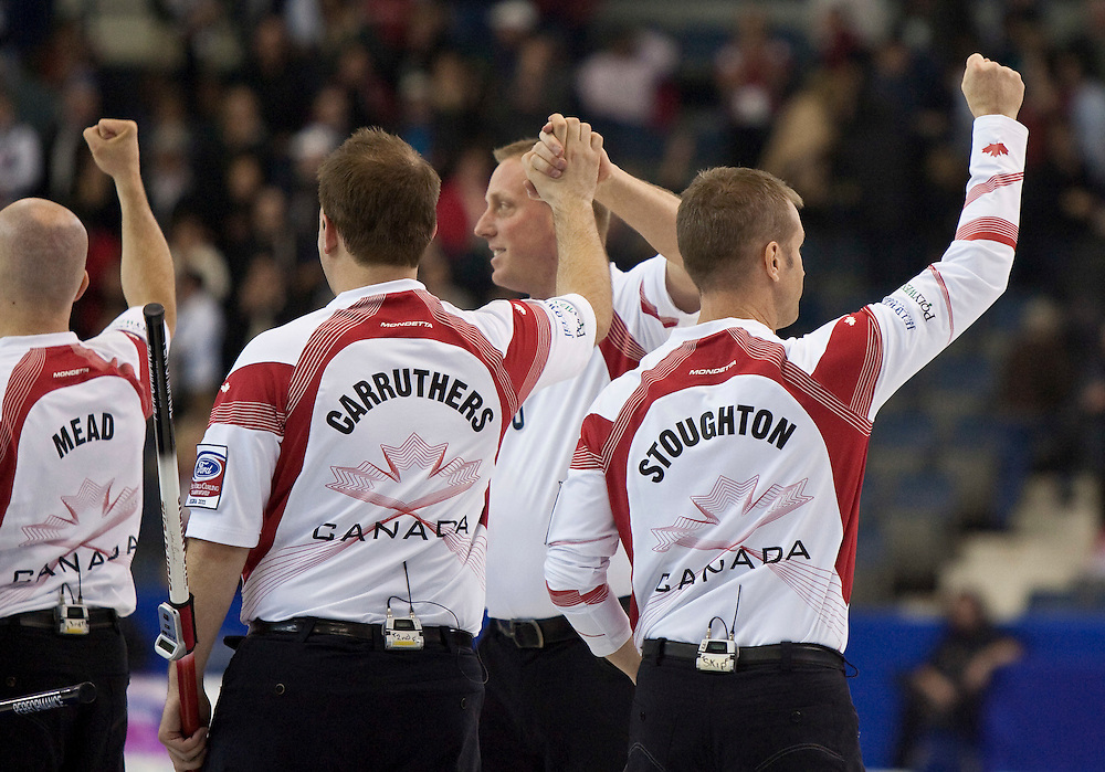 Skip Jeff Stoughton and team Canada celebrate their 5-4 win over Scotland in the 1-2 playoff match at the Ford World Men's Curling Championships in Regina, Saskatchewan, April 8, 2011 sending them to the final on Sunday.<br /> AFP PHOTO/Geoff Robins