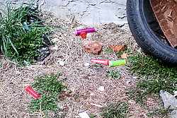 Drug paraphernalia litter the grounds of an empty lot, located on East Somerset Street in the Kensington neighborhood in Philadelphia, PA, on March 26, 2018. (Bastiaan Slabbers for WHYY)