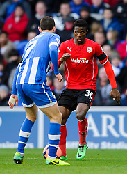 Cardiff Forward Wilfried Zaha (ENG) is challenged by Wigan Midfielder Chris McCann (IRL)  - Photo mandatory by-line: Rogan Thomson/JMP - 07966 386802 - 15/02/2014 - SPORT - FOOTBALL - Cardiff City Stadium - Cardiff City v Wigan Athletic - The FA Cup Fifth Round Proper.