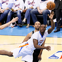 06 May 2016: Oklahoma City Thunder guard Dion Waiters (3) goes for the layup past San Antonio Spurs guard Tony Parker (9) during the San Antonio Spurs 100-96 victory over the Oklahoma City Thunder, during Game Three of the Western Conference Semifinals of the NBA Playoffs at the Chesapeake Energy Arena, Oklahoma City, Oklahoma, USA.