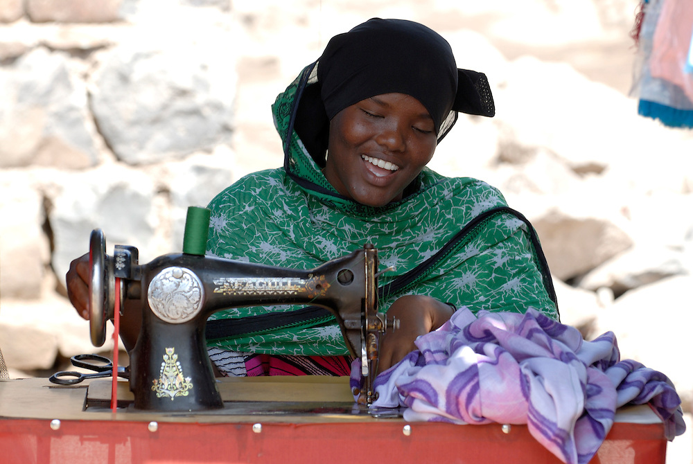 Tailoress having fun while she is working, Central Djibouti