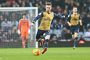 Arsenal's Aaron Ramsey on the ball during the Barclays Premier League match between Aston Villa and Arsenal at Villa Park, Birmingham, England on 13 December 2015. Photo by Shane Healey.