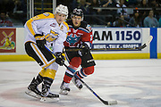 KELOWNA, CANADA - DECEMBER 03:  Calvin Thurkauf #27 of the Kelowna Rockets, Tyler Coulter #21 of the Brandon Wheat Kings at the Kelowna Rockets game on December 03, 2016 at Prospera Place in Kelowna, British Columbia, Canada.  (Photo By Cindy Rogers/Nyasa Photography,  *** Local Caption ***