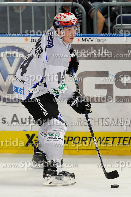 11.09.2015, SAP Arena, Mannheim, GER, DEL, Adler Mannheim vs Schwenninger Wild Wings, 1. Runde, im Bild Schwenningens Simon Danner (Nr.14) mit dem Puck // during the German DEL Icehockey League 1st round match between Adler Mannheim and Schwenninger Wild Wings at the SAP Arena in Mannheim, Germany on 2015/09/11. EXPA Pictures &copy; 2015, PhotoCredit: EXPA/ Eibner-Pressefoto/ Rufler<br /> <br /> *****ATTENTION - OUT of GER*****