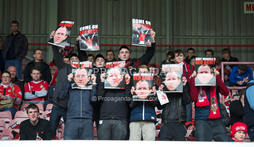 WREXHAM, WALES - Monday, May 7, 2012: Wrexham supporters wearing face masks of player-manager Andrew Morrell during the Football Conference Premier Division Promotion Play-Off 2nd Leg against Luton Town at the Racecourse Ground. (Pic by David Rawcliffe/Propaganda)