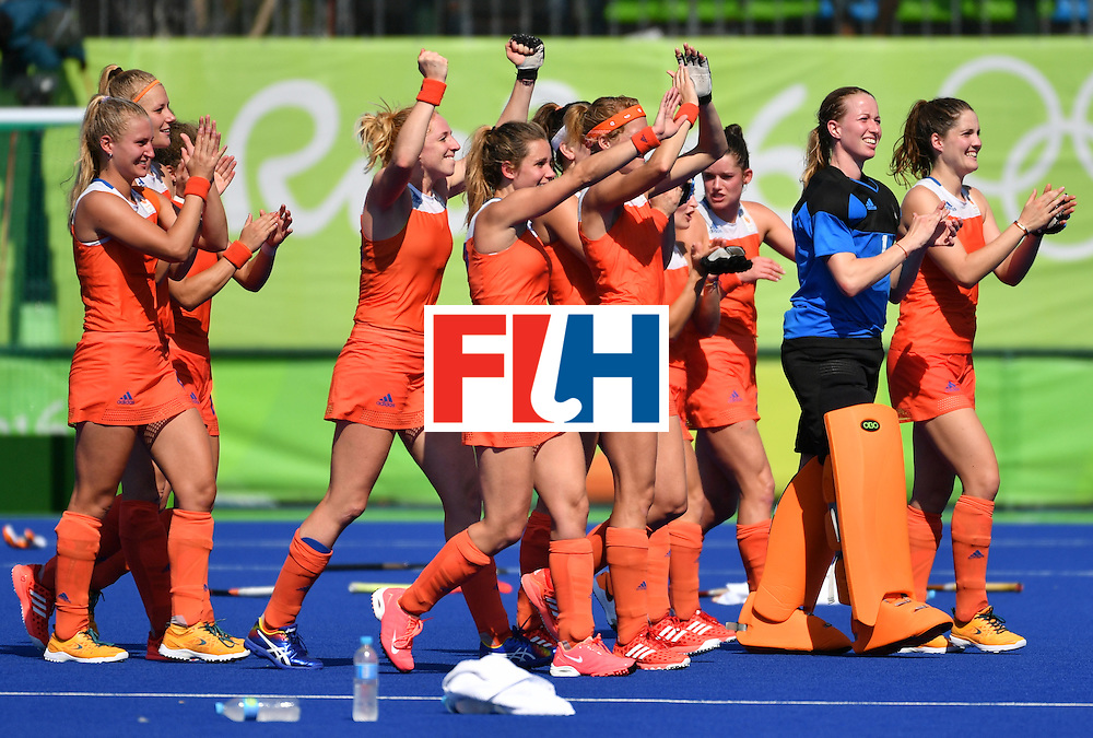 Netherlands' players celebrate after the penalty shoot-out at the end of the the women's semifinal field hockey Netherlands vs Germany match of the Rio 2016 Olympics Games at the Olympic Hockey Centre in Rio de Janeiro on August 17, 2016. / AFP / Pascal GUYOT        (Photo credit should read PASCAL GUYOT/AFP/Getty Images)