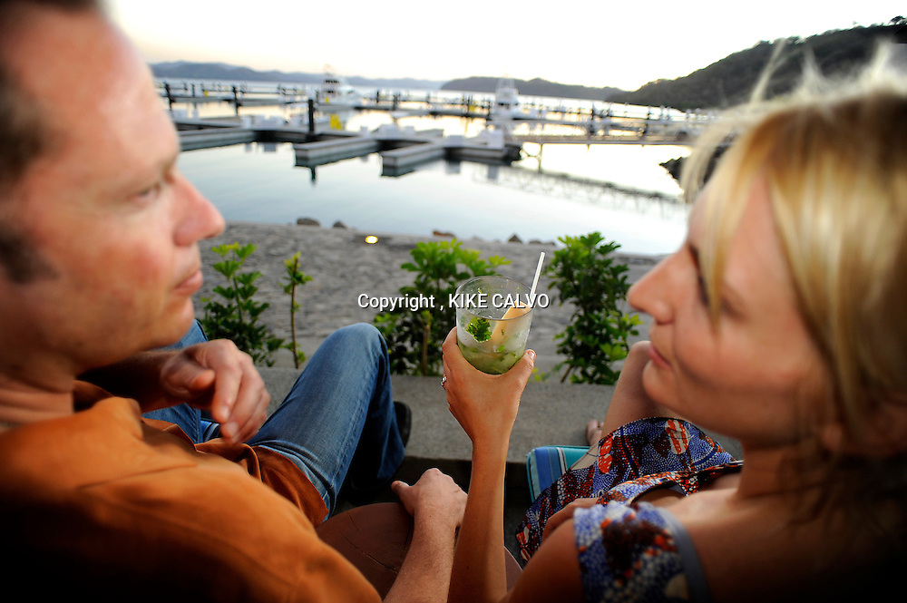 Peninsula Papagayo on Costa Rica's north Pacific Coast.Pictured: A couple enjoys the sunset at the new Marina Papagayo in Bahia Culebra. B1276