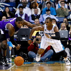 December 15, 2010; Sacramento Kings center Jason Thompson (34) and New Orleans Hornets point guard Chris Paul (3) scramble for a loose ball during the second half at the New Orleans Arena. The Hornets defeated the Kings 94-91. Mandatory Credit: Derick E. Hingle