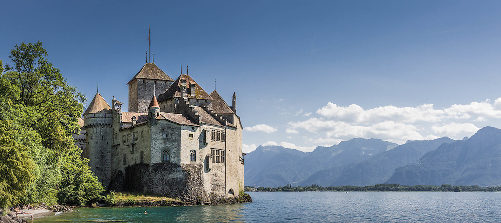 Chillon Castle is an island castle located on Lake Geneva, south of Veytaux in the canton of Vaud. It is situated at the eastern end of the lake, on the narrow shore between Montreux and Villeneuve.