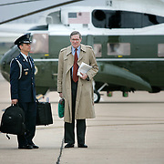 Pres. Bush's choice to be his new National Security Advisor, Stephen Hadley, right, stands by the military aide carrying the nuclear codes, as Bush and first lady Laura Bush board Air Force One Friday, November 19, 2004, in Ft. Hood, TX...Photo by Khue Bui