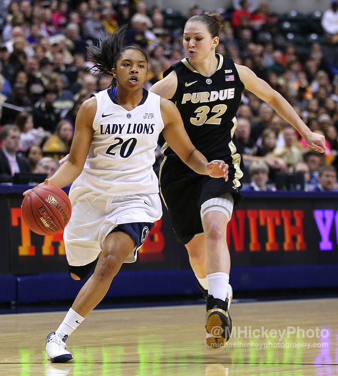 March 03, 2012; Indianapolis, IN, USA; Penn State Lady Lions guard Alex Bentley (20) dribbles the ball up court as Purdue Boilermakers guard/forward Sam Ostarello (32) trails behind during the semifinals of the 2012 Big Ten Tournament at Bankers Life Fieldhouse. Purdue defeated Penn State 68-66. Mandatory credit: Michael Hickey-US PRESSWIRE