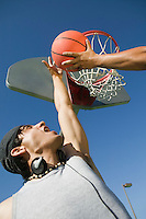 Two men playing basketball low angle view.