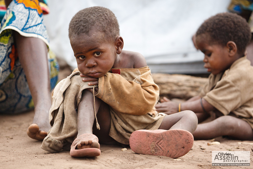 A child sits on the ground at the Miketo IDP settlement, Katanga province, Democratic Republic of Congo on Sunday February 19, 2012.