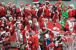 © under license to London News Pictures.  12/12/2010 Trafalgar Square, London. Londoners dressed in Santa Claus costumes participate in 'SantaCon', a Santa-themed pub crawl across London yesterday (11/12/2010). Similar SantaCon events take place in various cities around the world, with an emphasis on having fun and spreading seasonal good cheer to passers by. Photo credit should read: London News Pictures