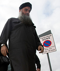 © London News Pictures. 13/11/2012. London, UK. Radical Preacher Abu Qatada arriving at his bail home in London after being released from prison following a successful appeal against his extradition to Jordan where he was convicted of terror charges in his absence in 1999. Photo Credit: Ben Cawthra/LNP