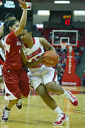 27 March 2011:  Shala Jackson lowers her shoulder to keep Yashira Delgado from the ball during a WNIT (Women's National Invitational Tournament Women's basketball sweet 16 game between the Arkansas Razorbacks and the Illinois State Redbirds at Redbird Arena in Normal Illinois.