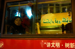 An ethnic Uighur woman looks out from a bus window in Urumqi city, Xinjiang Uighur Autonomous Province, China, 18 November 2017. Uighurs, a Muslim ethnic minority group in China, make up about 40 per cent of the 21.8 million people in Xinjiang, a vast, ethnically divided region that borders Pakistan, Afghanistan, Kazakhstan, Kyrgyzstan and Mongolia. Other ethnic minorities living in here include the Han Chinese, Kyrgyz, Mongolian and Tajiks people. Xinjiang has long been subjected to separatists unrests and violent terrorist attacks blamed by authorities on Islamist extremism while human rights groups say Chinese repression on religious rights, culture and freedom of movement caused undue tensions. Life however goes on under the watchful eye of the government for the ethnic Uighurs living in the city of Urumqi and surrounding areas and the region is still considered an attractive tourist spot. A recent report by state media Xinhua news agency claims Xinjiang received more than 100 million tourists in 2017, 'the highest figure in its history'.