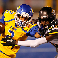 Thomas Wells | Buy at PHOTOS.DJOURNAL.COM<br /> Tupelo running back Donte Freeman is brought down by Hernando's Desean Bullock as the Golden Wave win 31-0 on Homecoming.