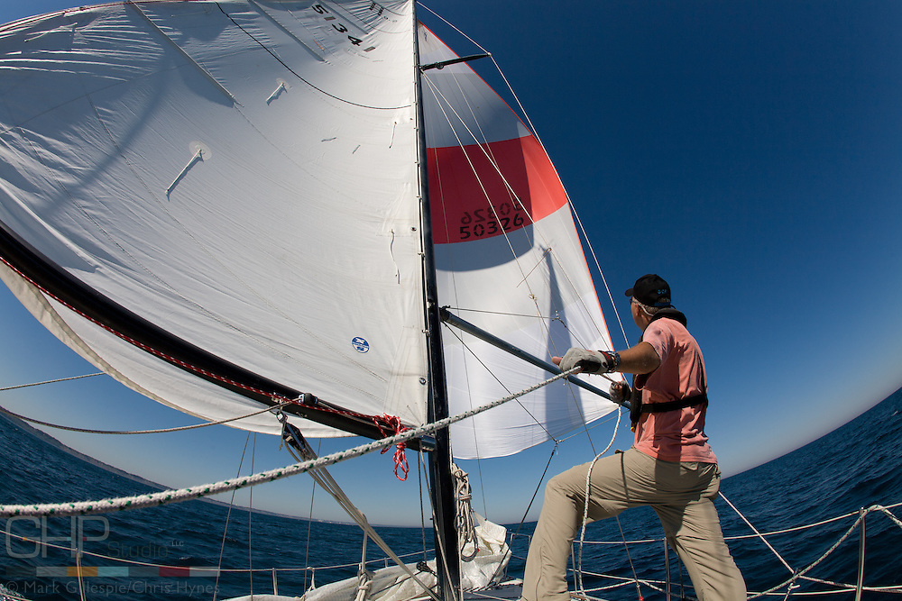 Tom French trims the spinnaker while daysailing on Lake Michigan.
