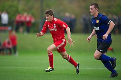 LIVERPOOL, ENGLAND - Friday, October 14, 2011: Liverpool's Adam Morgan in action against Manchester United during the FA Premier League Academy match at the Kirkby Academy. (Pic by David Rawcliffe/Propaganda)